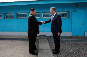 PANMUNJOM, SOUTH KOREA - APRIL 27: North Korean Leader Kim Jong Un (L) and South Korean President Moon Jae-in (R) shake hands over the military demarcation line upon meeting for the Inter-Korean Summit on April 27, 2018 in Panmunjom, South Korea. Kim and Moon meet at the border today for the third-ever inter-Korean summit talks after the 1945 division of the peninsula, and first since 2007 between then President Roh Moo-hyun of South Korea and Leader Kim Jong-il of North Korea. (Photo by Korea Summit Press Pool/Getty Images)