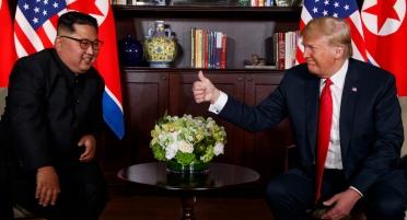 President Donald Trump meets with North Korean leader Kim Jong Un on Sentosa Island, Tuesday, June 12, 2018, in Singapore. (AP Photo/Evan Vucci)